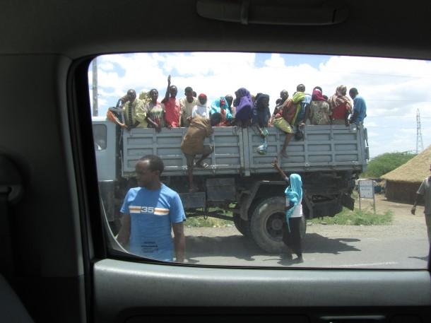 Men riding a truck